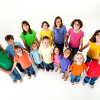 Group of happy children on a white background.